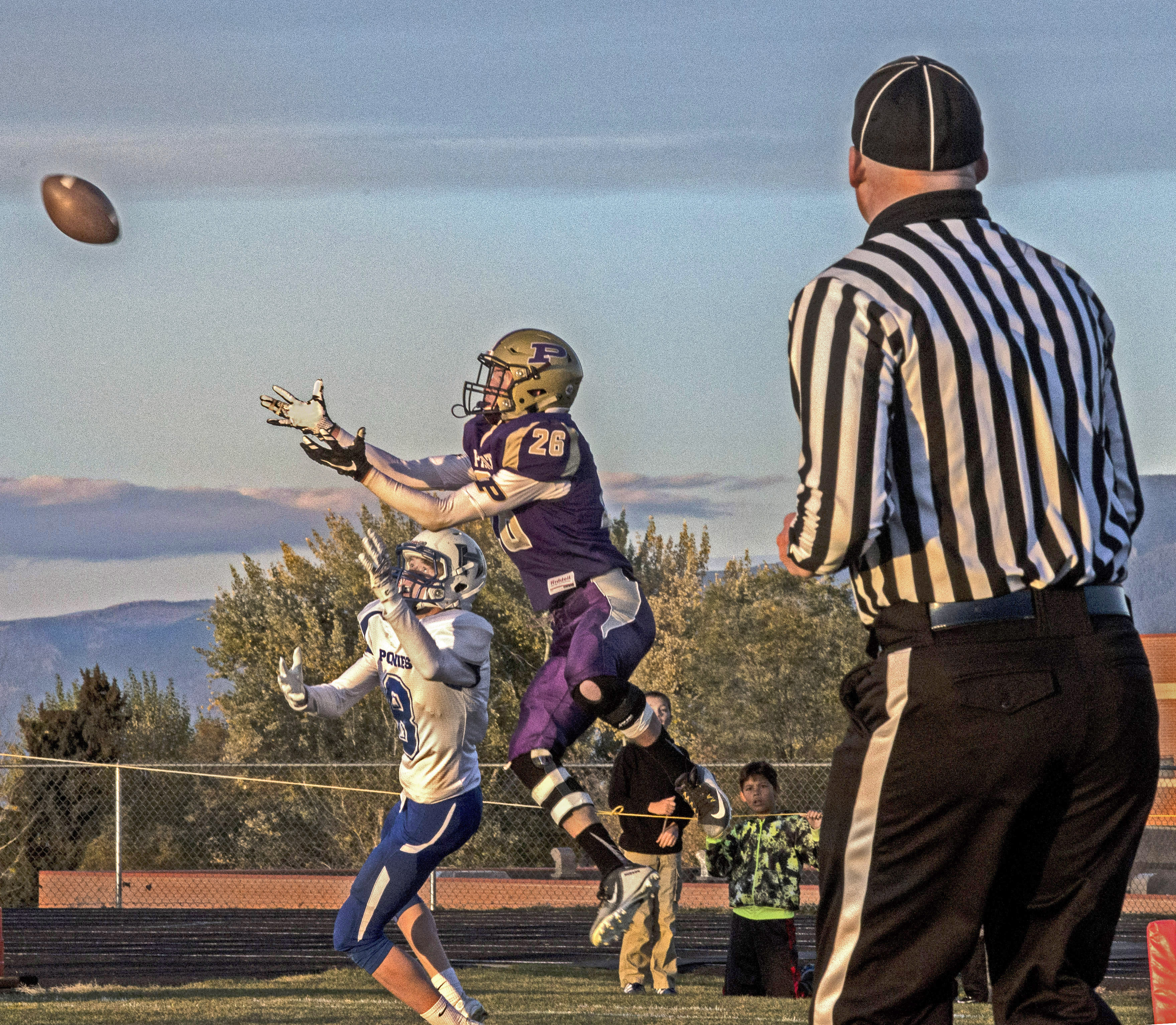 Hudson Smith receiving a pass at Polson High School.